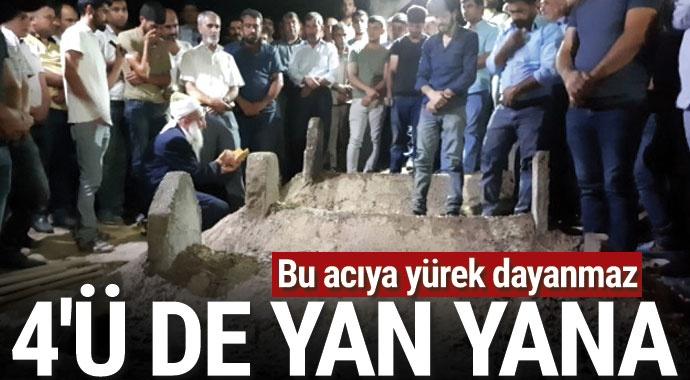 Diyarbakır'da baraj gölünde boğulan 4 kadının cenazesi yan yana defnedildi
